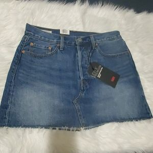 Women denim distressed mini skirt